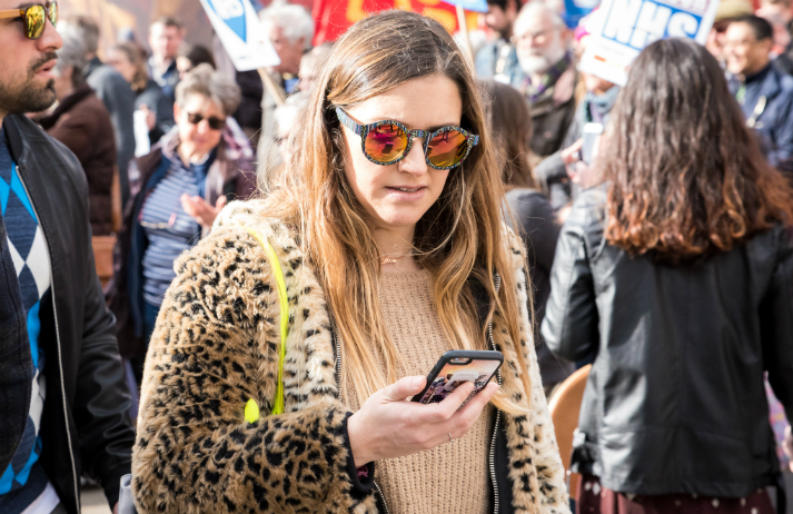 How can 'social labelling' encourage people to spend?