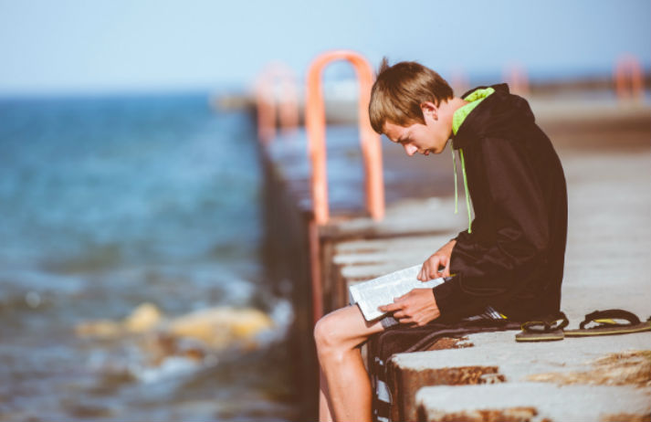 How can a book support boys during adolescence?